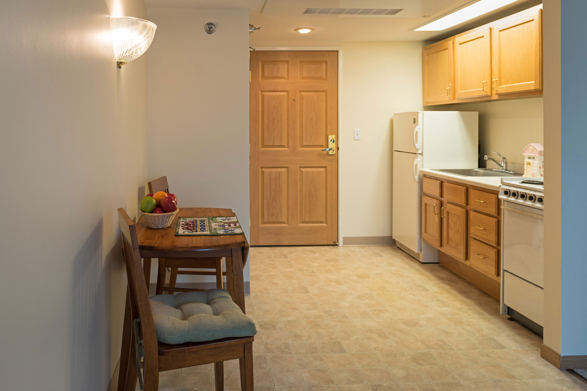 Kitchen and sitting area in a room at Epiphany Senior Living
