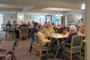 Seniors chatting in the cafeteria at Epiphany Senior Housing